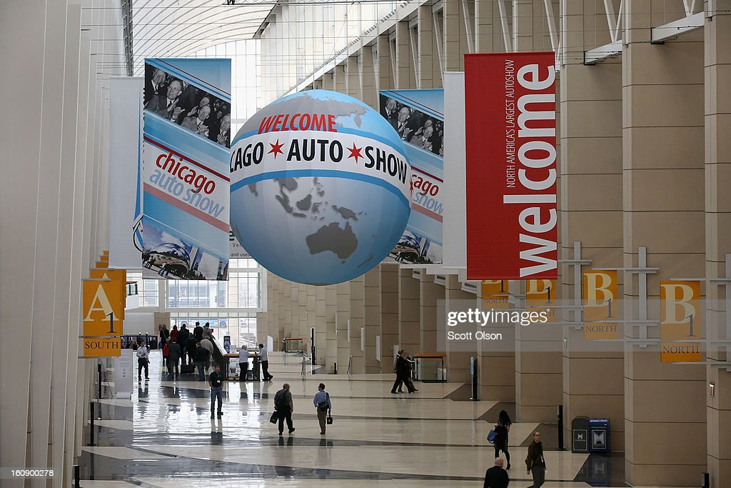 Visitors attend the media preview at the Chicago Auto Show on February 7, 2013 in Chicago, Illinois. The Chicago Auto Show, one of the oldest and largest in the country, will be open to the public February 9-18.
