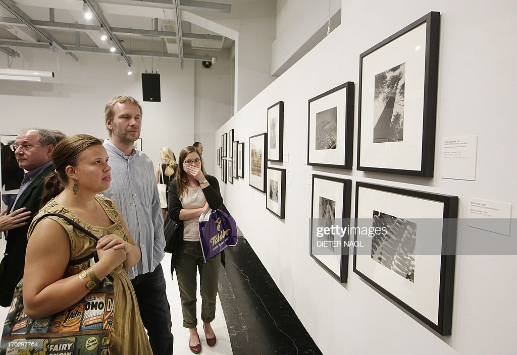 Visitors attend the opening of an exhibition of Russian photographer Alexander Rodchenko named «the photographic revolution» at Westlicht Gallery on June 10, 2013 in Vienna