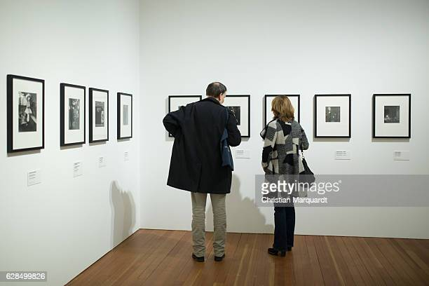 Visitors attend the 'Robert Doisneau Fotografien' press conference and exhibition preview at Martin Gropius Bau on December 8 2016 in Berlin Germany...