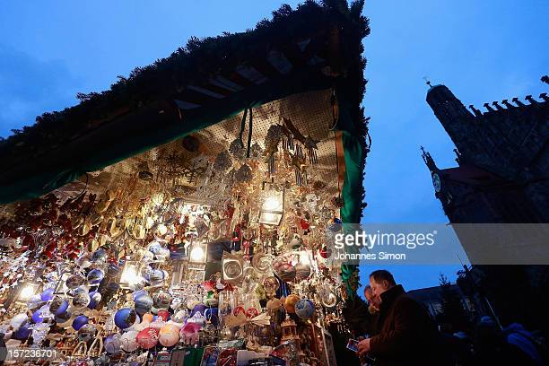 Visitors attend the traditional Christmas market 'Nuernberger Christkindlesmarkt' ahead of the opening ceremony on November 30 2012 in Nuremberg...
