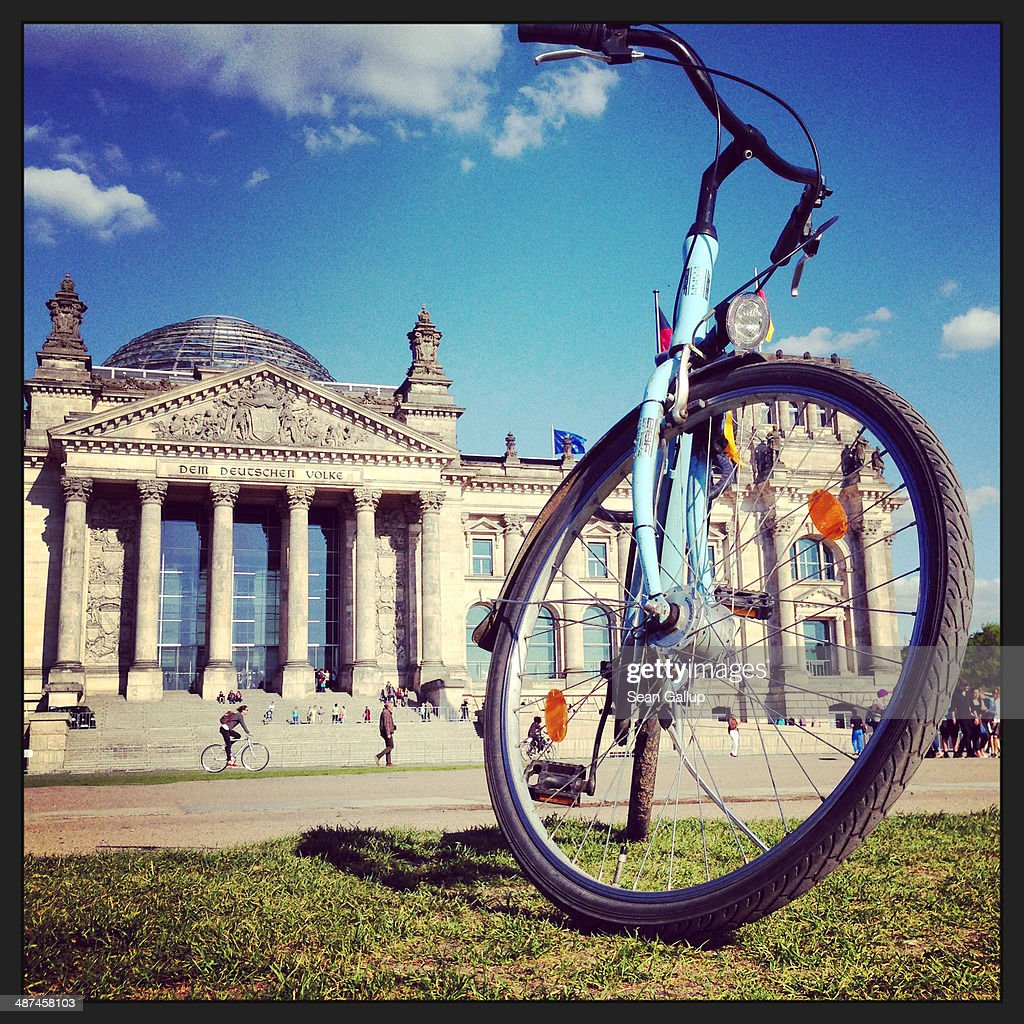 A visitor's bicycle stands outside the Reichstag on April 28, 2014 in Berlin, Germany. The Reichstag, home of the Bundestag, the German parliament, is among the city's major landmarks and a favourite tourist destination.