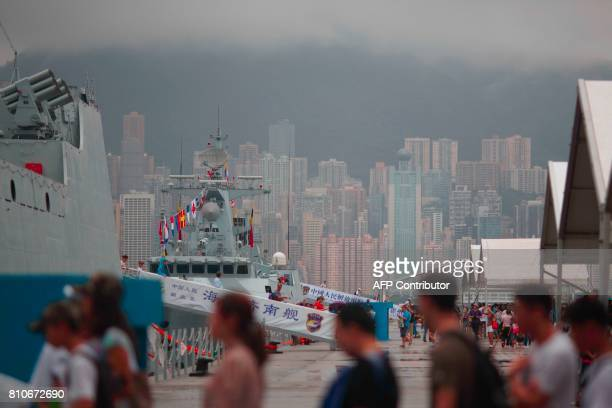 Visitors board the Chinese People's Liberation Army Navy destroyer Jinan and frigate Huizhou at the Ngong Shuen Chau naval base on Stonecutters...