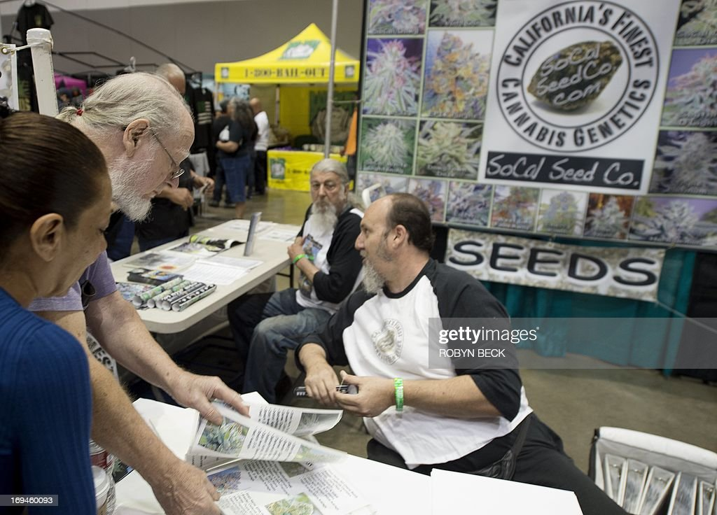 Visitors browse catalogues of marijuana seeds at the HempCon medical marijuana show, May 24, 2013 at the Los Angeles Convention Center. Thousands of marijuana enthusiasts gathered for the three-day event for exhibits of medical marijuana dispensaries, collectives, evaluation services, legal services and equipment and accessories. Under California state law, people suffering from chronic diseases have the right to grow, buy and use marijuana for medical purposes when recommended by a doctor. In 2003 the Medical Marijuana Protection Act, established an identification card system for medical marijuana patients.