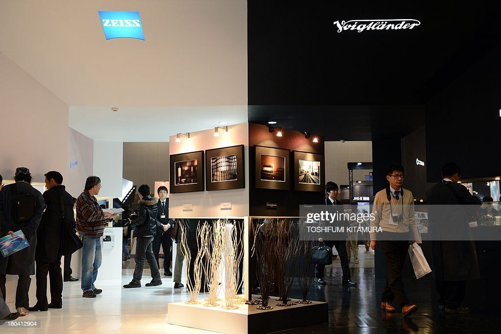 Visitors browse Cosina's Zeiss and Voitlander booths during the CP+, (CP plus) photo imaging show in Yokohama on January 31, 2013. Around 96 companies are participating in the exhibition with some 70,000 visitors expected in the four-day-long event.