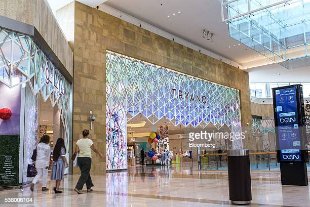 Visitors browse retail stores at the Yas Island Mall in Abu Dhabi United Arab Emirates on Monday May 30 2016 Abu Dhabi which sits on six percent of...