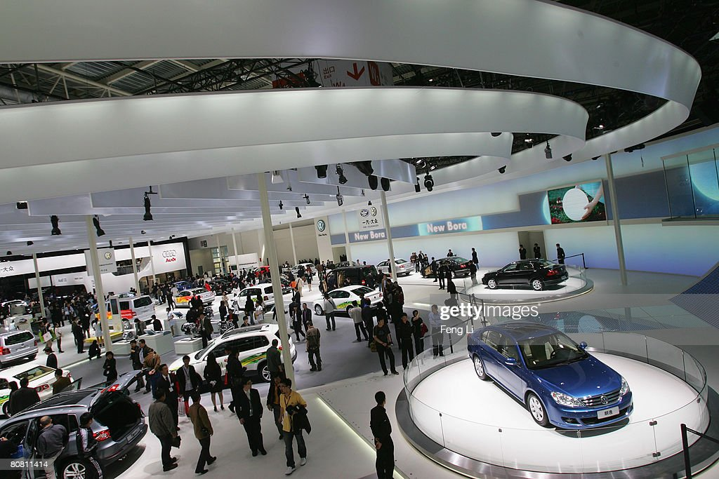 Visitors browse the Volkswagen section during a special media opening of the Auto China 2008 show at the new China International Exhibition Center on April 21, 2008 in Beijing, China. The annual auto show is held from April 20-28 with 890 vehicles including 55 concept cars on show.