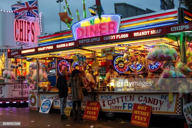 Visitors buy food from a stall at the Nottingham Goose Fair in the Forest Recreation Ground on October 7 2017 in Nottingham England The annual goose...