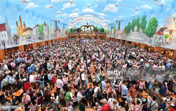 Visitors celebrate in the beer tent 'HackerPschorr Himmel der Bayern' at day 2 of the 2017 Oktoberfest beer festival on September 17 2017 in Munich...