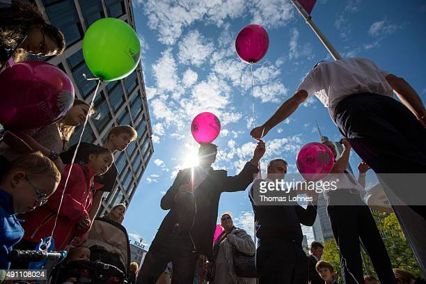 Visitors celebrate with balloons with the logo of the Federal Assembly during the 25th anniversary of German reunification on October 3 2015 in...