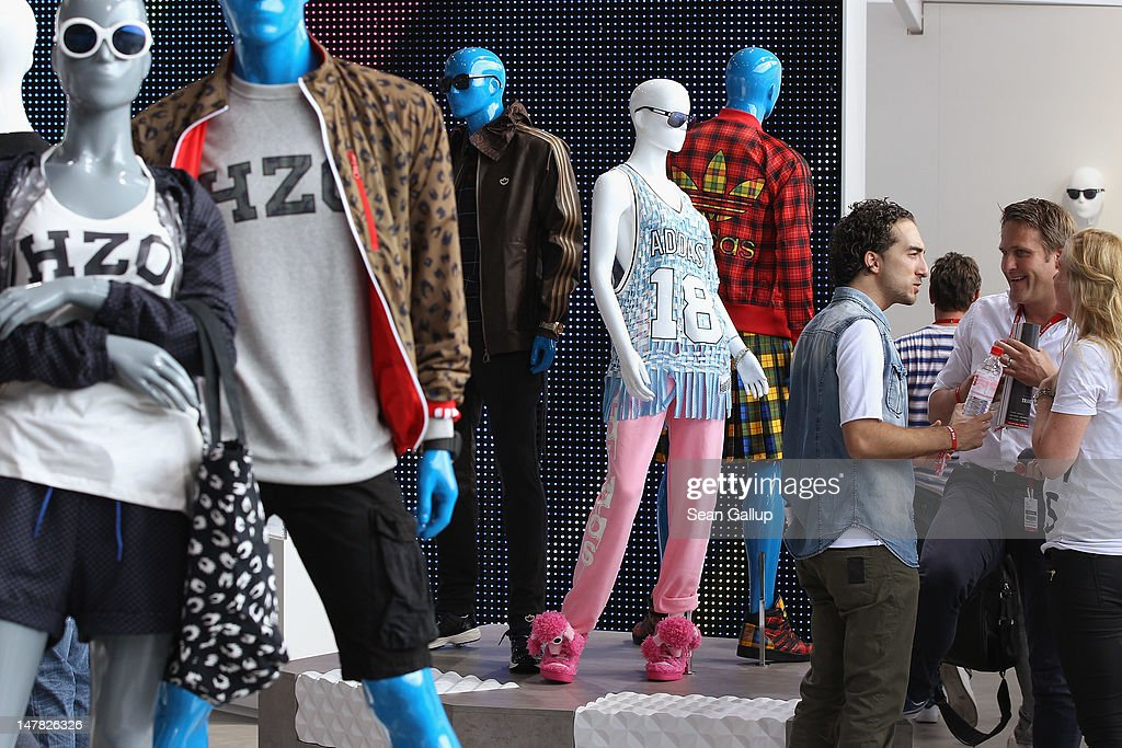 Visitors chat at the adidas Originals Spring/Summer 13 collection at the Bread and Butter 2012 fashion trade fair on July 4, 2012 in Berlin, Germany.