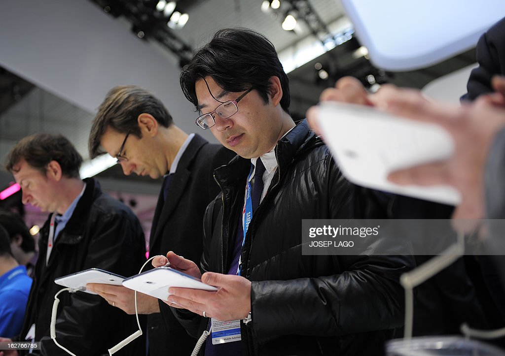 Visitors check a Galaxy note tablet by Samsung at the 2013 Mobile World Congress in Barcelona on February 26, 2013. The 2013 Mobile World Congress, the world's biggest mobile fair, is held from February 25 to 28 in Barcelona.