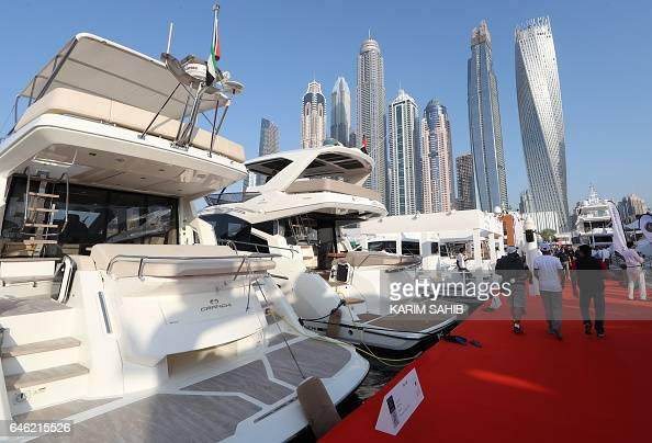 Visitors check boats docked at the Dubai International Marine Club during the Gulf emirate's international Boat Show on February 28 2017 / AFP /...
