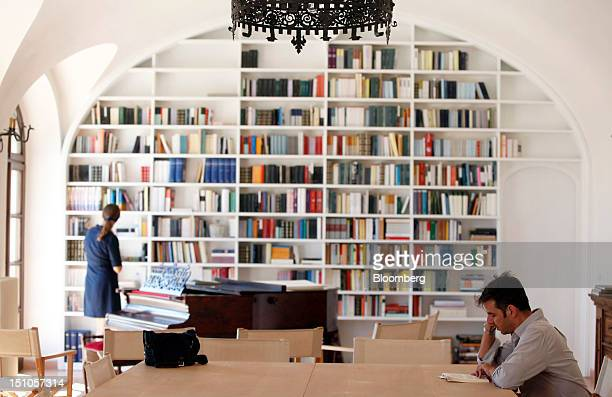 Visitors check books inside a library at Brunello Cucinelli SpA's production facility in Solomeo near Perugia Italy on Thursday Aug 30 2012 Cucinelli...