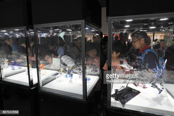 Visitors check displayed models at Gundam Base Tokyo at Gundam Base Tokyo on August 19 2017 in Tokyo Japan Gundam mania swooped into the capital on...