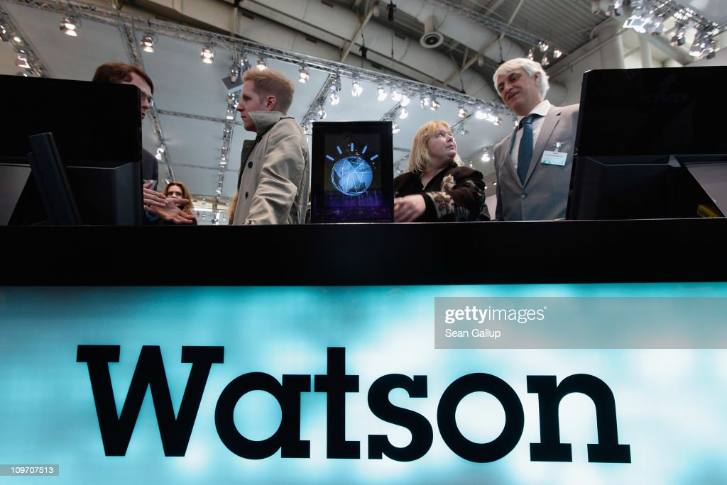Visitors check out a slimmed down version of the IBM Watson supercomputer recently featured on the Jeopardy television game show at the IBM stand at the CeBIT technology trade fair on March 2, 2011 in Hanover, Germany. CeBIT 2011 will be open to the public from March 1-5.
