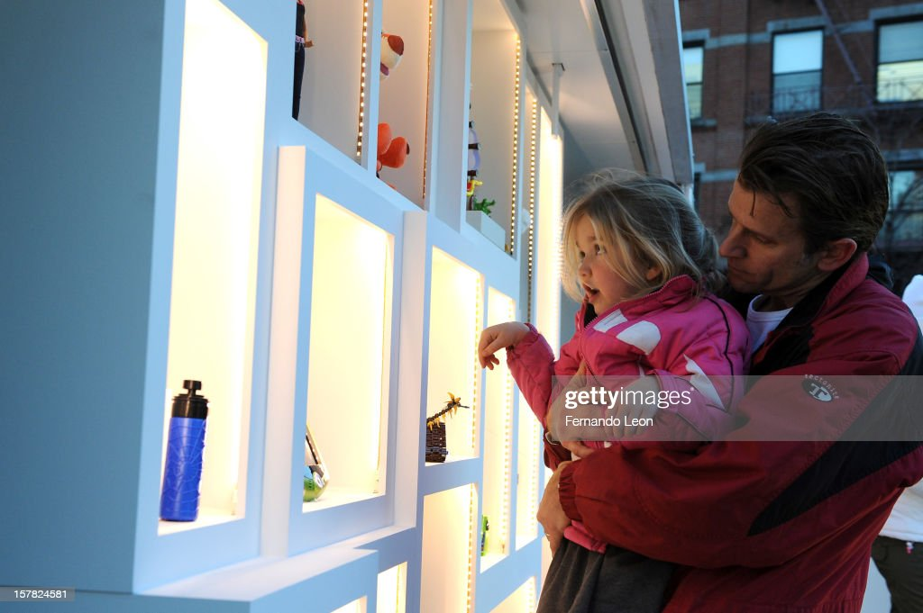 Visitors check out eBay's new way to give and get the season's hottest toys with mobile at The eBay Toy Box in New York City on December 6, 2012.