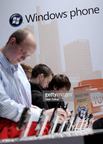 Visitors check out mobile phones using the Microsoft Windows mobile phone operating system at the CeBIT Technology Fair on March 2 2010 in Hannover...
