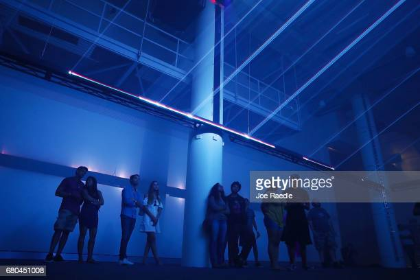 Visitors check out the LasersHow exhibit on opening day for the Phillip and Patricia Frost Museum of Science on May 8 2017 in Miami Florida The...