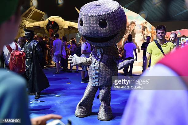 Visitors check out the latest games at the Gamescom fair in Cologne western Germany on August 7 2015 The trade fair for interactive games is running...