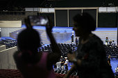 Visitors check out the main stage of the Democratic National Convention at the Wells Fargo Center on July 23 2016 in Philadelphia Pennsylvania...