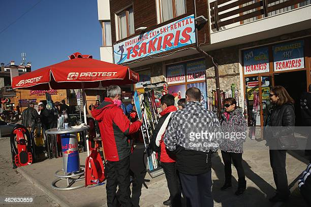 Visitors check out the offerings a ski rental shop at the Bansko ski resort on January 13 2014 in Bansko Bulgaria Located in the Pirin mountains in...