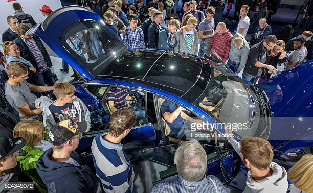 Visitors check out the Tesla Model S a car with an advanced electric powertrain in Tesla stand at the 66th International Auto Show in Frankfurt...