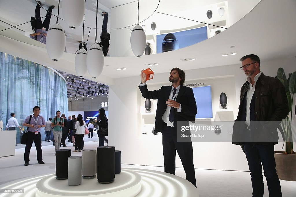 Visitors check out the Wireless Audio 360 sound system at the Samsung stand during a press day at the 2015 IFA consumer electronics and appliances...