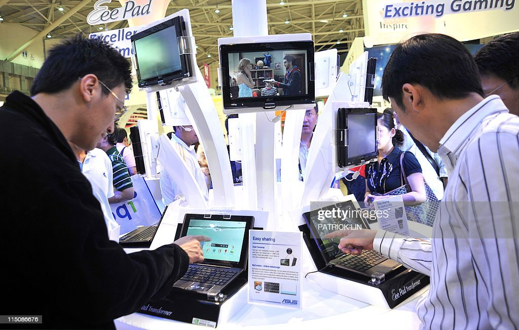 Visitors check various types of tablet computers at a booth of Taiwan's AsusTek Computer on June 3, 2011 on the fourth day of the five-day Computex Taipei , Asia's biggest information technology and communications trade fair. Tablets that match the iPad but at a cheaper price. Slimmer, more powerful notebooks. At Computex, Asia's top IT fair, manufacturers are showing how they plan to face the challenge from Apple's iconic product.