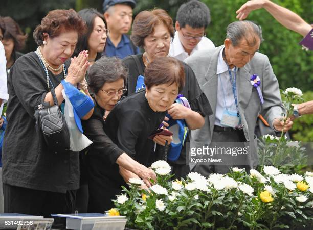 Visitors commemorate unidentified World War II dead at Chidorigafuchi National Cemetery in Tokyo on Aug 15 the 72nd anniversary of Japan's surrender...