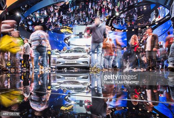 Visitors crowd around a new Opel Astra car at the 66th IAA auto show in Frankfurt am Main western Germany on September 19 2015 AFP PHOTO / DPA /...