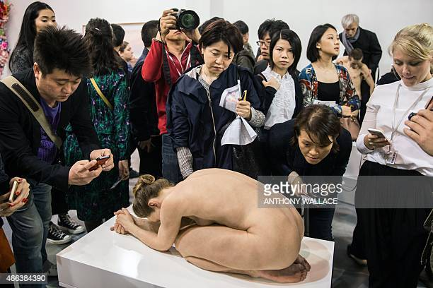 Visitors crowd around Australian artist Sam Jinks' 'Untitled ' at the Art Basel fair in Hong Kong on March 15 2015 Hong Kong's biggest art fair Art...