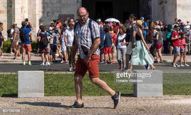 Visitors crowd the entrance of Jeronimos Monastery a main tourist attraction protected by recently installed anti terrorist blocks on August 22 2017...