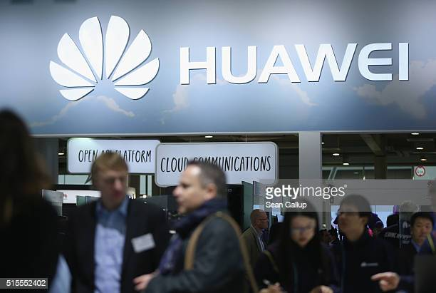 Visitors crowd the Huawei stand at the 2016 CeBIT digital technology trade fair on the fair's opening day on March 14 2016 in Hanover Germany The...