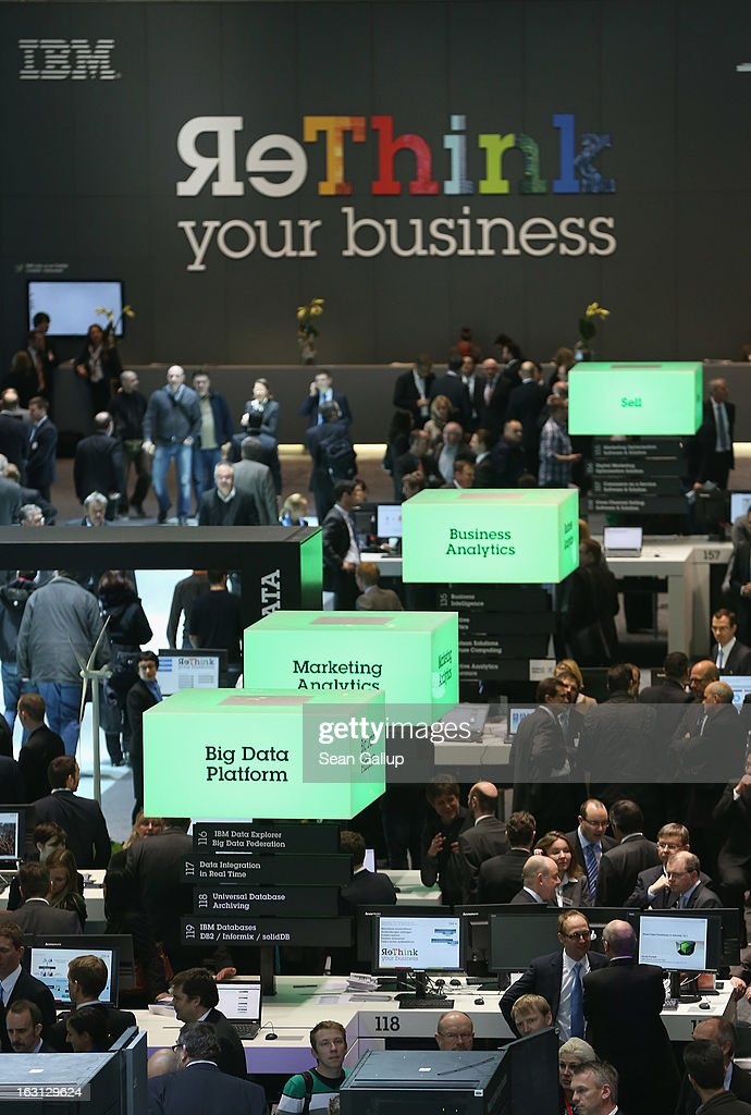 Visitors crowd the IBM stand at the 2013 CeBIT technology trade fair on March 5, 2013 in Hanover, Germany. CeBIT will be open March 5-9.