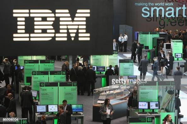 Visitors crowd the IBM stand under an IBM logo at the 2009 CeBIT technology trade fair on March 4 2009 in Hanover Germany CeBIT the world's largest...