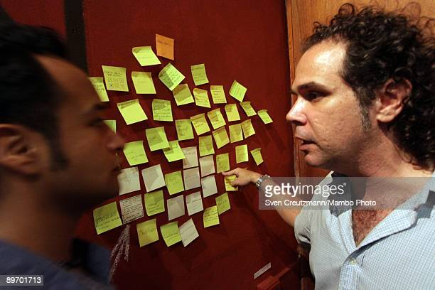 Visitors discuss A piece by Cuban artists Luis Garciga Renier Quer Grethell Rasua Celia Gonzalez Yunior Aguiar Javier Castro 'Hasta Abril del 2009'...