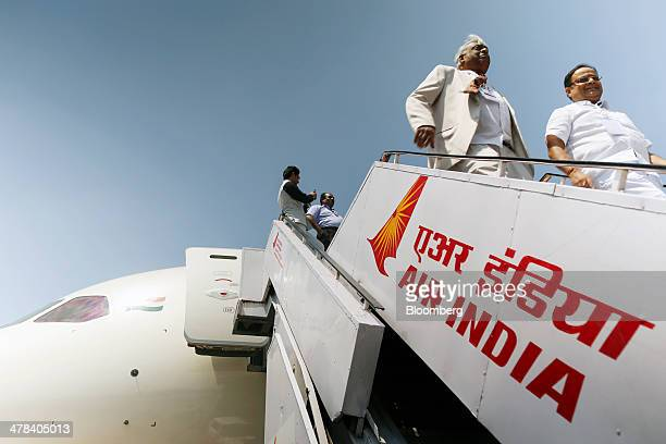 Visitors disembark a Boeing Co 787 Dreamliner aircraft operated by Air India Ltd on display during the India Aviation 2014 air show held at the...