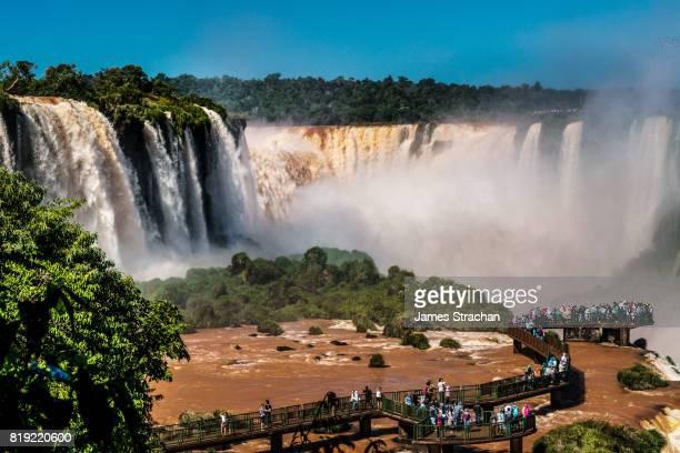 Visitors, drenched in spray, on walkway in the middle of the Garganta del Diablo (Devil's Throat), Iguazu Falls (UNESCO World Heritage Site) from Brazilian side, Iguazu, Brazil