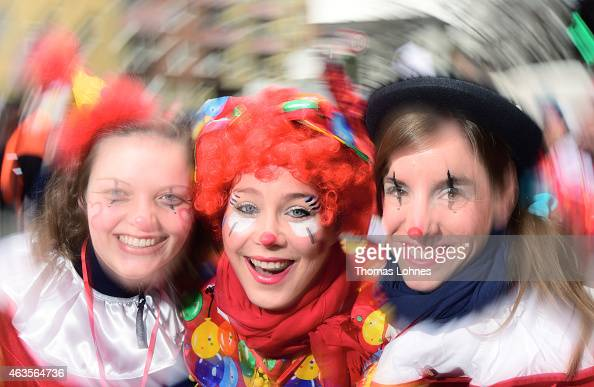 Visitors dress up as clowns participates in the annual Rose Monday carnival parade on February 16 2015 in Mainz Germany Rose Monday in German called...