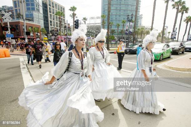 Visitors dressed in Cosplay costumes cross the street to the San Diego Convention Center during Comic Con International on July 20 2017 in San Diego...