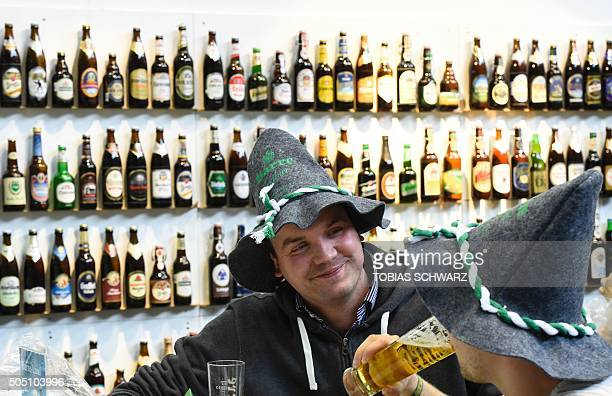 Visitors drink beer at the opening day of the 'Gruene Woche' agricultural fair in Berlin on January 15 2016 The International Green Week opens its...