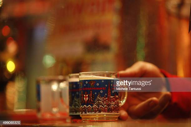 Visitors drink mull wine at the annual christmas market on November 28 2015 in Freiburg in Breisgau Germany Christmas markets are opening across...