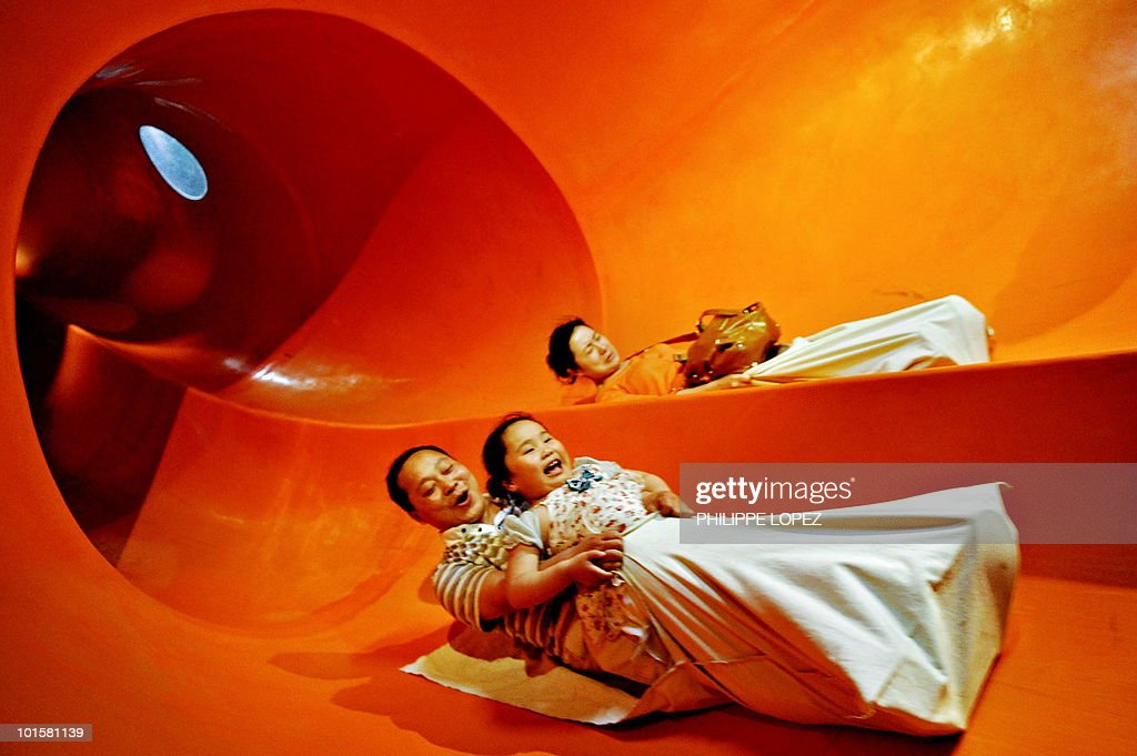 Visitors enjoy a slide inside the Swedish pavilion at the site of the World Expo 2010 in Shanghai on May 18, 2010. Organisers expect 70 million visitors -- most of them Chinese -- to attend the biggest-ever World's Fair, with an average of 380,000 people expected to visit the site daily.