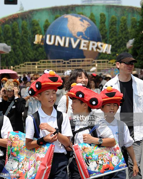 Visitors enjoy a tour at the movie theme park Universal Studios Japan in Osaka on May 10 2012 USJ unveiled plans to build the first international...