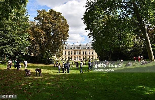 Visitors enjoy at the garden of the Elysee Palace where the deals and decisions forming the world's agenda are made opened for people to visit in...