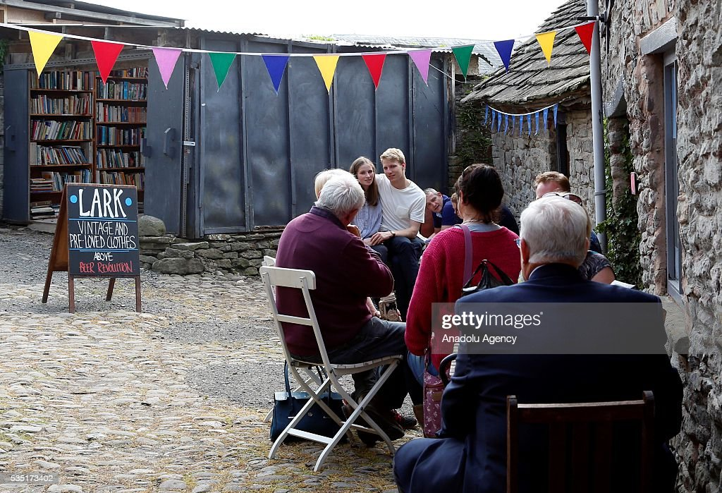Visitors enjoy at the Hay Festival, on May 29, 2016 in Hay-on-Wye, Wales. The Hay Festival is an annual festival of literature and arts now in its 29th year.