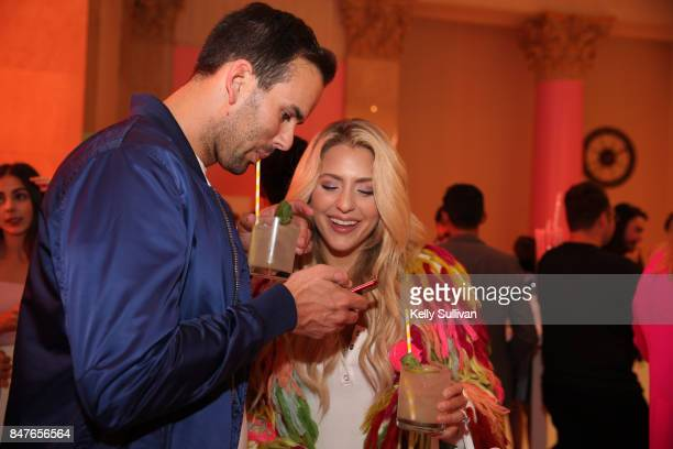 Visitors enjoy beverages at Museum of Ice Cream opening party on September 15 2017 in San Francisco California