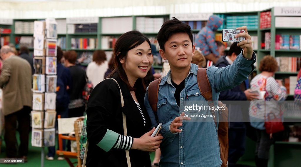 Visitors enjoy during the Hay Festival on May 29, 2016 in Hay-on-Wye, Wales. The Hay Festival is an annual festival of literature and arts now in its 29th year.