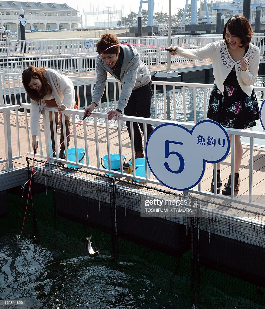 Visitors enjoy fishing during a press preview of Yokohama Hakkeijima SeaParadise's new attraction facilities, 'Umi Farm,' or Sea Farm in Yokohama on February 28, 2013. The 'Umi Farm' opens on March 8 and will teach children about the ocean's ecological nature as well as fishing or hunting fish.