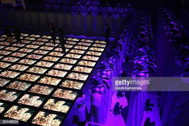 Visitors enjoy images displayed on the floor with multiscreen vision at the theater of 'Open Your Mind' produced by Japan's famous animator Mamoru...
